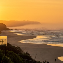 Sonnenaufgang am Wilderness Beach, Südafrika
