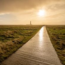 Wind, Sonne und strömender Regen